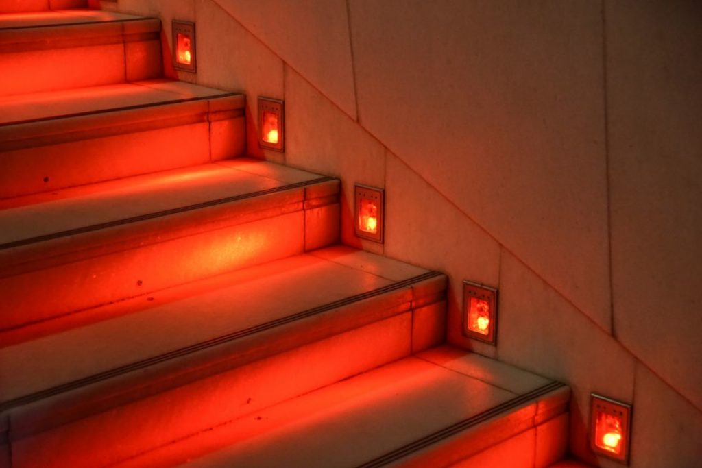 Red LED lighting on stairs. Effective LED lighting.