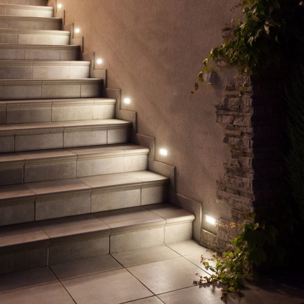 Beautiful illuminated terrace stairs. Exclusive stair LED lighting system