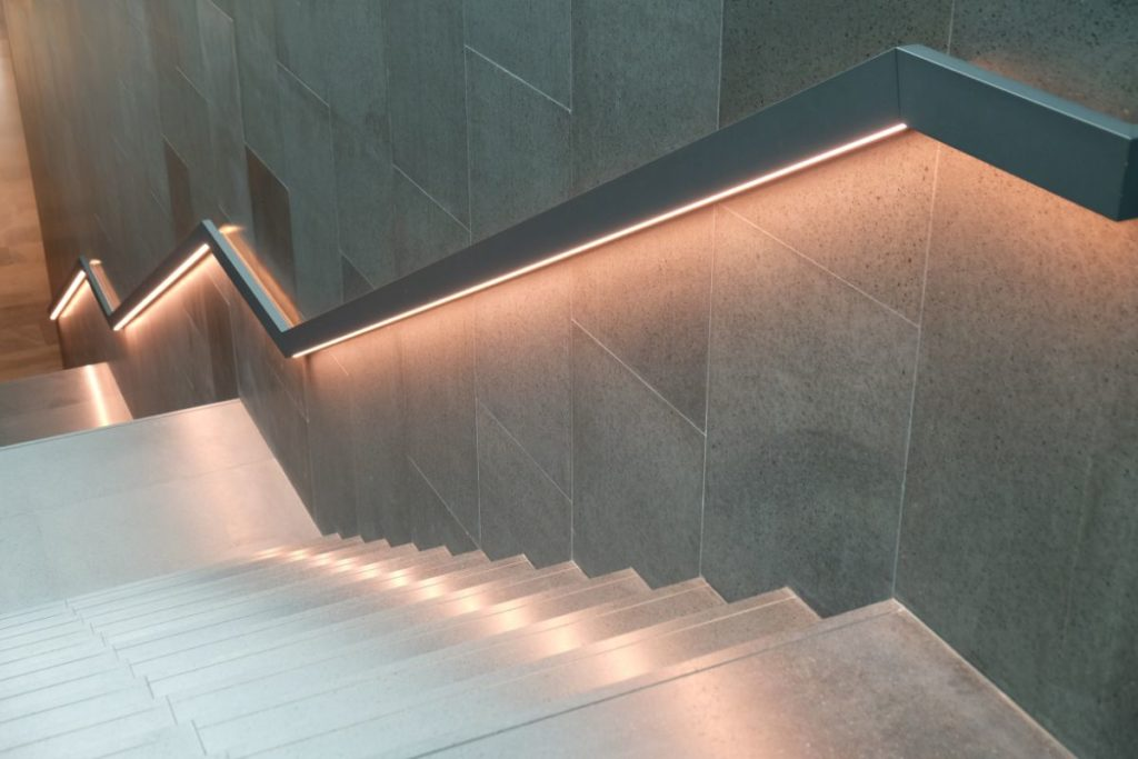 Interior design staircase with indirect lighting within the handrail - smart stairway