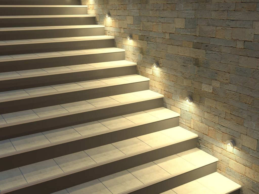 Modern smart stairs. Staircase with backlit steps. Soft night lighting.