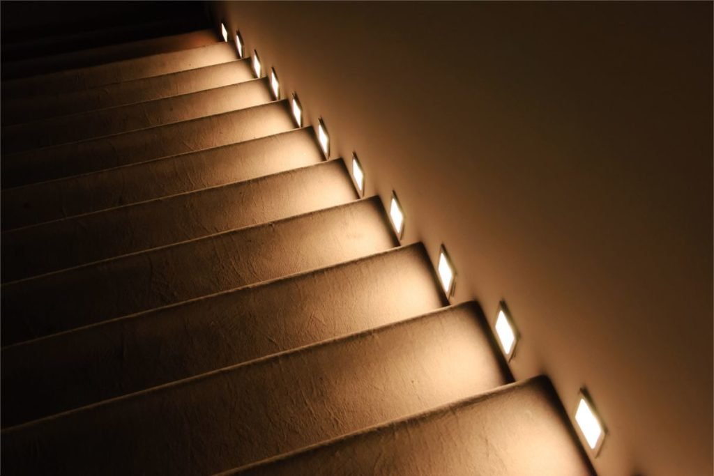 Side lighting of stairs. Intelligent stairway.